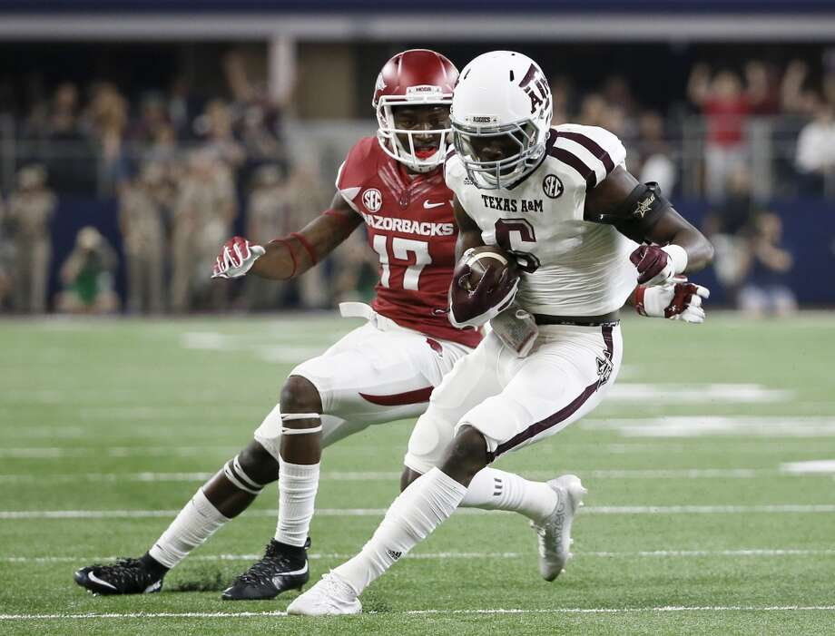 Texas A&M defensive back Donovan Wilson (6) comes away with an interception on a pass intended for Arkansas wide receiver JoJo Robinson (17) during the first half of an NCAA college football game Saturday, Sept. 26, 2015, in Arlington, Texas. (AP Photo/Tony Gutierrez) Photo: Associated Press