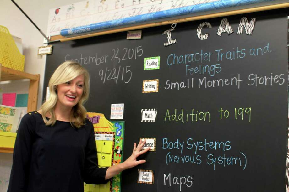 """Christine Dismuke, a Morton Ranch Elementary School second-grade teacher, is a finalist to be Texas Association of School Administrators' elementary teacher of the year. She says she wants to show her class  positive ways to face life's challenges. """"I want to make sure I seem as human as possible to them; so that they understand that we all have struggles, and it's OK,"""" she says.          Christine Dismuke, a Morton Ranch Elementary School second-grade teacher, is a finalist to be Texas Association of School Administrators' elementary teacher of the year. She says she wants to show her class  positive ways to face life's challenges. """"I want to make sure I seem as human as possible to them; so that they understand that we all have struggles, and it's OK,"""" she says. Photo: Suzanne Rehak, Freelance Photographer"""