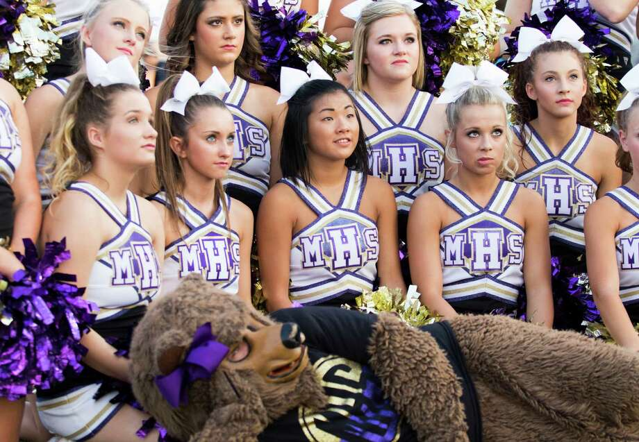 Montgomery Bears' cheerleaders get instruction from ESPN before doing pre-game promotional clips before a high school football game at George Stadium on Thursday, Setember 24, 2015, in Spring. ( Joe Buvid / For the Chronicle ) Photo: Joe Buvid, Freelance / © 2015 Joe Buvid