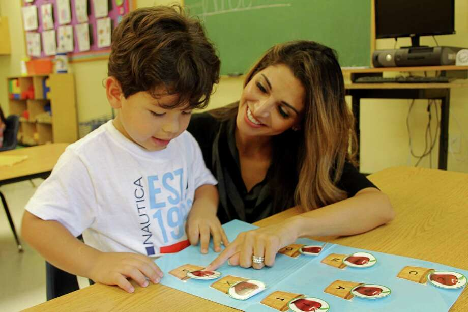 Diego Muniz  of Katy matches upper and lower case letters at Children's Lighthouse Learning Center as owner Veronica Guerra observes. The center and others in the area have been upgrading curriculums to keep pace with teaching philosophies and technological developments.   Diego Muniz  of Katy matches upper and lower case letters at Children's Lighthouse Learning Center as owner Veronica Guerra observes. The center and others in the area have been upgrading curriculums to keep pace with teaching philosophies and technological developments. Photo: Suzanne Rehak, Freelance Photographer
