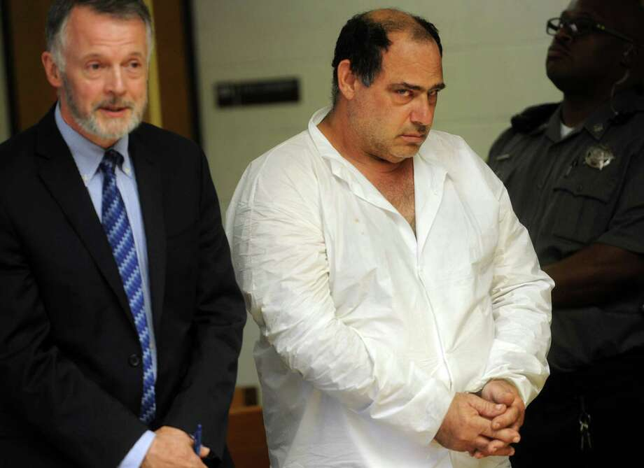 Thomas Infante, of Shelton, stands with his attorney, John Gulash, during his arraignment on a murder charge Tuesday at state Superior Court in Derby. He is accused of killing Lisa Infante, his wife of 27 years. Photo: Brian A. Pounds / Hearst Connecticut Media / Connecticut Post