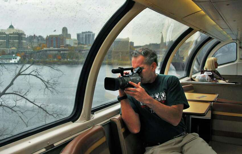 A rail buff videotapes from the historic