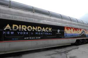 The exterior of the Amtrak dome car that gives a panoramic view of the Adirondack fall foliage during the fall.