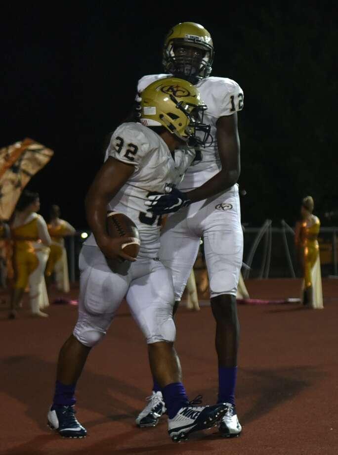 Klein Collins senior running Justin Pratt (32) celebrates his touchdown against Klein Oak with teammate and junior wide receiver Jaylon Johnson (12) last week. Photo: Jerry Baker, Freelance