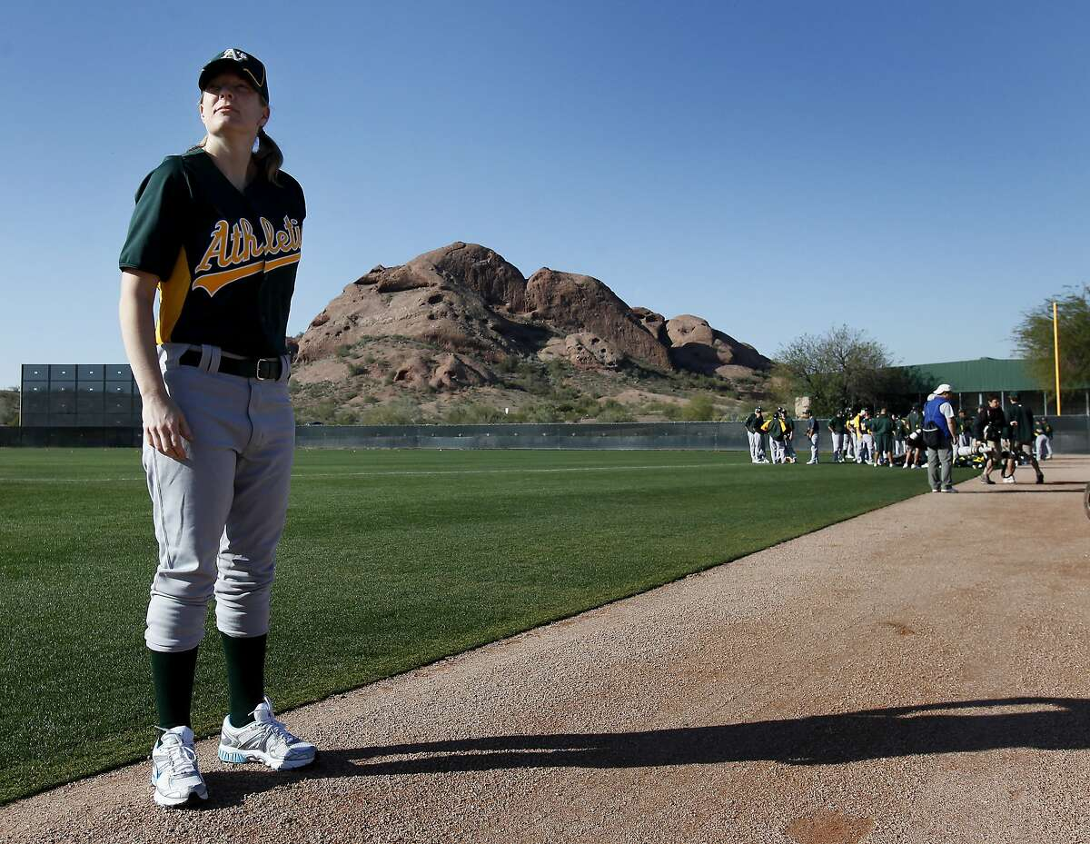 Justine Siegal waits for her chance to pitch batting practice to the Oakland A's. She recently made history by becoming the first woman to pitch major league batting practice in the Arizona area. The Oakland Athletics held a workout at the Papago Park facilities Wednesday February 23, 2011 in Phoenix, Arizona.