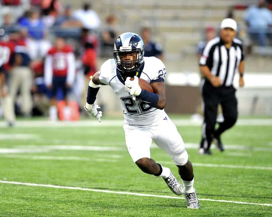 Cy Ridge running back Trelon Smith (22) found plenty of running room in the game against Cy Springs. Photo: Eddy Matchette, Freelance / Freelance