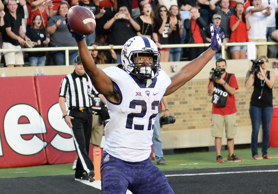 Aaron Green of the TCU Horned Frogs celebrates after catching a tipped ball in the end zone for the game-winning touchdown late in the fourth quarter against the Texas Tech Red Raiders on Sept. 26, 2015 at Jones AT&T Stadium in Lubbock, Texas. TCU won the game 55-52. Photo: John Weast /Getty Images / 2015 Getty Images