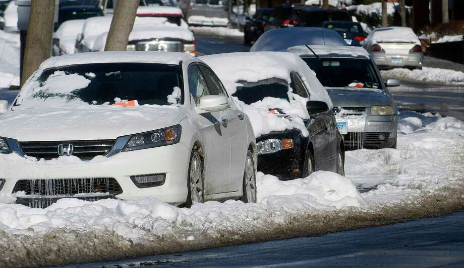 Cars parked on Morgan Street were ticketed for being on a snow emergency route on Wednesday, January 22, 2014. Photo: Lindsay Perry / Lindsay Perry / Stamford Advocate