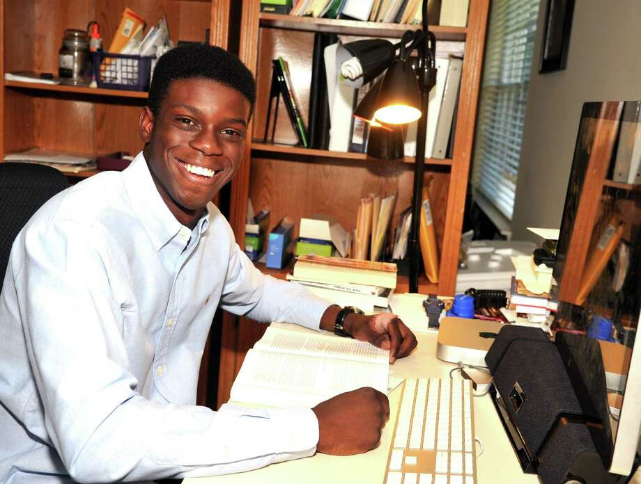 Although he is only 17, Cypress Woods High School senior Toby Nzewi is the founder and leader of a group that fosters business startups in Africa. Photo: Eddy Matchette, Freelance / Freelance