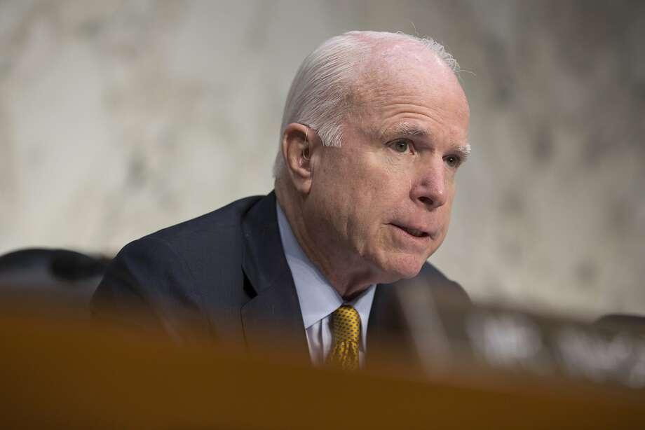 Sen. McCain was happy the bill extends ban on torture. Photo: Evan Vucci, Associated Press