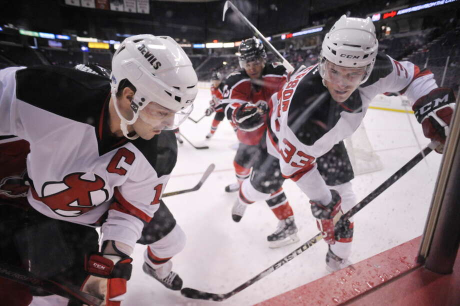 Rod Pelley, left, and Corbin McPherson of the Albany Devils control the puck along the boards in their game against the Portland Pirates at the Times Union Center on Sunday, Nov. 2, 2014, in Albany, N.Y.  (Paul Buckowski / Times Union) ORG XMIT: MER2014110217485493 Photo: Paul Buckowski / 00029212C