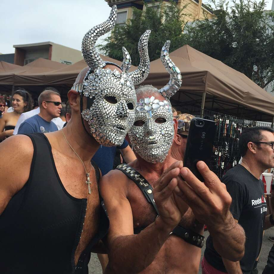 Masks were a trend at this year's Folsom Street Fair, the annual September leather festival in SoMa. Photo: Carolyne Zinko, San Francisco Chronicle