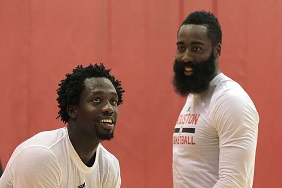 Houston Rockets guard Patrick Beverley left, shoots the ball as Rockets guard James Harden right, looks on during the Rockets practice at the Toyota Center Tuesday, Sept. 29, 2015, in Houston.  ( James Nielsen / Houston Chronicle )