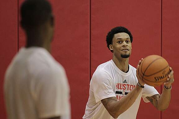 Houston Rockets guard K.J. McDaniels shoots the ball during the Rockets practice at the Toyota Center Tuesday, Sept. 29, 2015, in Houston.  ( James Nielsen / Houston Chronicle )