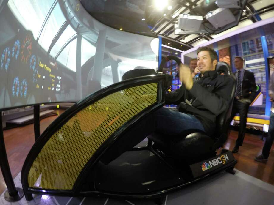 Nascar star Martin Truex Jr. takes a spin on a racing simulator during a visit to NBC Universal studios in Stamford to tape a segment for their NASCAR America Show on Tuesday. Truex is one of 16 drivers in the 2015 Chase for the NASCAR Sprint Cup championship. Photo: Matthew Brown / For Hearst Connecticut Media / Connecticut Post Freelance