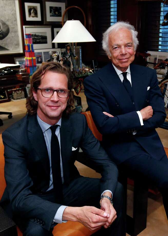 Designer Ralph Lauren, right, poses in his office with Stefan Larsson, global brand president for Old Navy, Tuesday, Sept. 29, 2015, in New York. Lauren is stepping down as CEO of the fashion and home decor empire that he founded nearly 50 years ago, and Larsson, who has been the global president of Old Navy for three years, will succeed him. (AP Photo/Jason DeCrow) ORG XMIT: NYJD126 Photo: Jason DeCrow / FR103966 AP