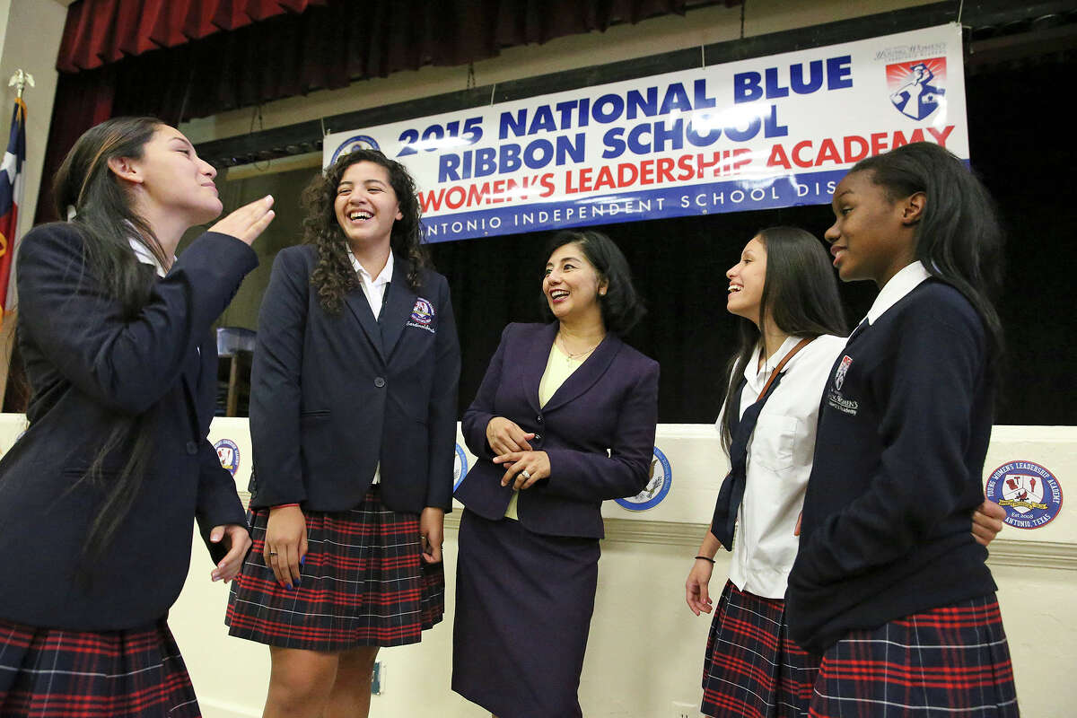 Students (from Left) Azeal Garza, Meg Garcia, Mallory Sanchez and Karease Williams are congratulated as Principal Delia McLerran announces to the student body assembled on September 29, 2015 at the SAISD's Young Women's Leadership Academy, that the school has been recognized as a 2015 National Blue Ribbon School on September 29, 2015.