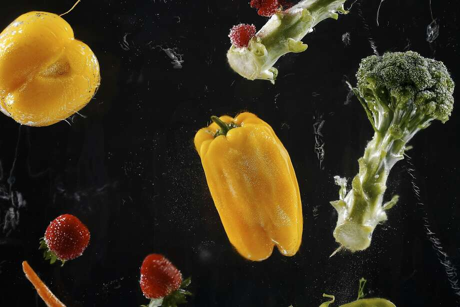 Fruits and vegetables frozen in a block of ice.  Photo: Russell Yip, The Chronicle