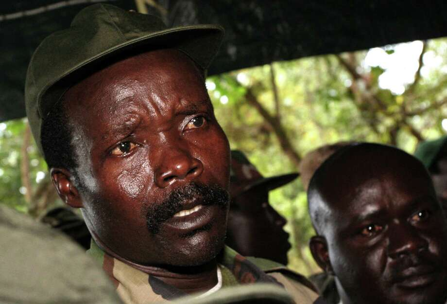 FILE - In this Nov. 12, 2006 file photo, the leader of the Lord's Resistance Army, Joseph Kony answers journalists' questions following a meeting with UN humanitarian chief Jan Egeland at Ri-Kwamba in southern Sudan. A video by the advocacy group Invisible Children about the atrocities carried out by jungle militia leader Joseph Kony's Lord's Resistance Army is rocketing into viral video territory and is racking up millions of page views seemingly by the hour. (AP Photo/Stuart Price, File, Pool) Photo: Stuart Price, POOL / ap