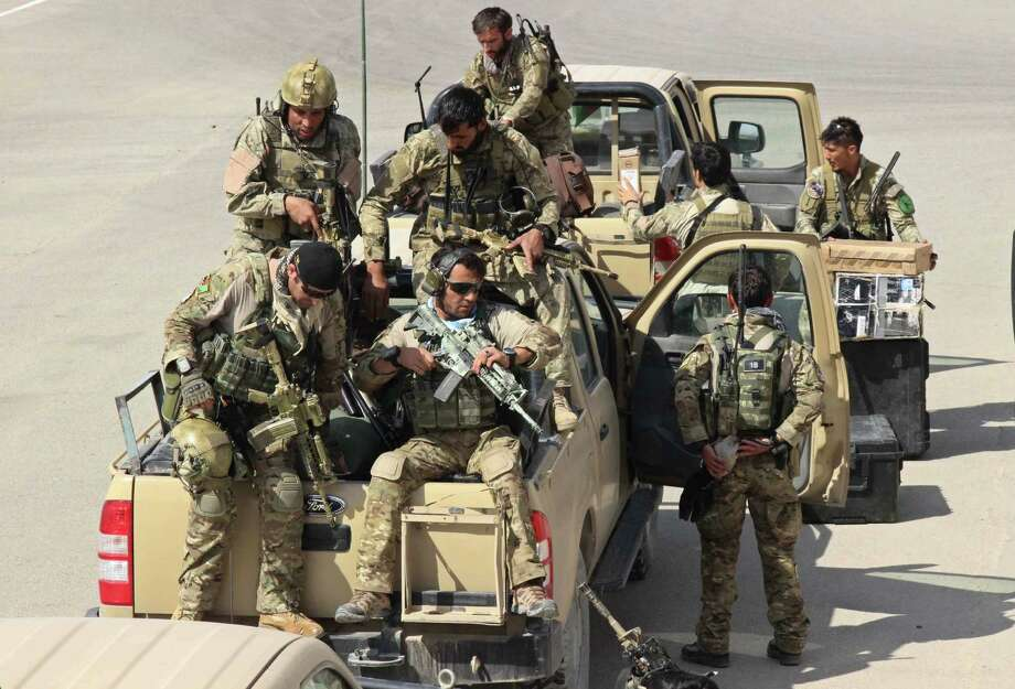 Afghan special forces arrive at the airport as they launch a counteroffensive to retake the city from Taliban insurgents, in Kunduz on Septmber 29, 2015. The Afghan army on September 29 launched a counter-offensive to retake Kunduz from the Taliban, a day after insurgents overran the strategic northern city.   AFP PHOTO / Nasir WaqifNASIR WAQIF/AFP/Getty Images Photo: NASIR WAQIF / AFP / Getty Images / AFP