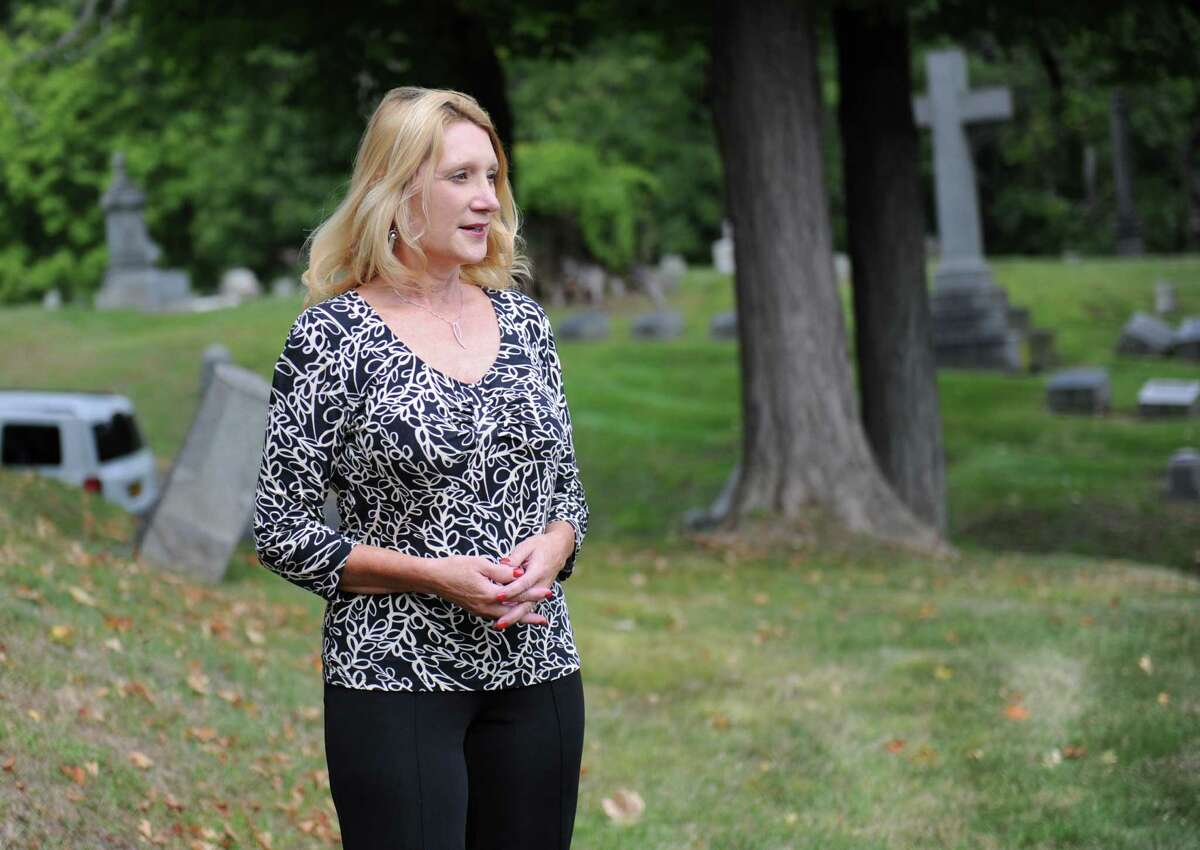 Kelly Grimaldi, historian at Albany Diocesan Cemeteries, looks at the view from the plot on Founders' Hill where the remains of 14 slaves of the Schuyler family will be re-interred next June at St. Agnes Cemetery on Tuesday, Sept. 29, 2015 in Menands, N.Y. The remains of the slaves were unearthed during construction in 2005. (Lori Van Buren / Times Union)