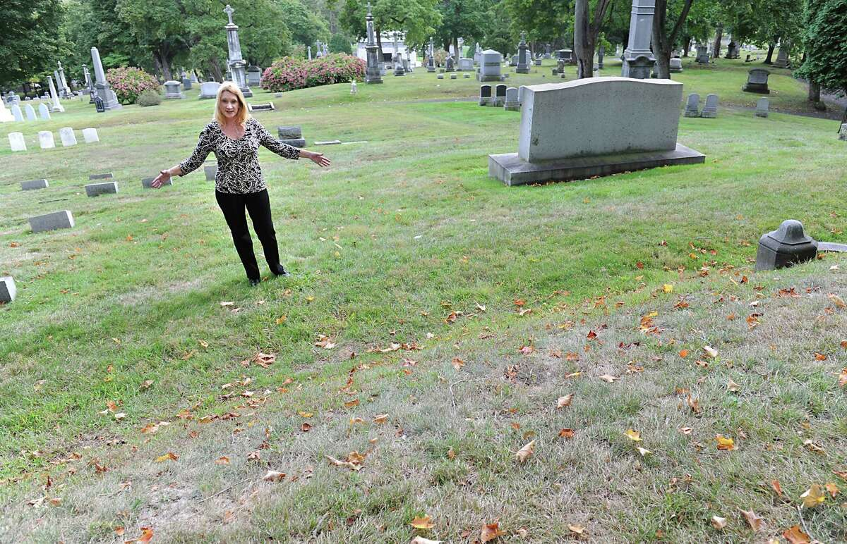 Kelly Grimaldi, historian at Albany Diocesan Cemeteries, shows the plot on Founders' Hill where the remains of 14 slaves of the Schuyler family will be re-interred next June at St. Agnes Cemetery on Tuesday, Sept. 29, 2015 in Menands, N.Y. The remains of the slaves were unearthed during construction in 2005. (Lori Van Buren / Times Union)