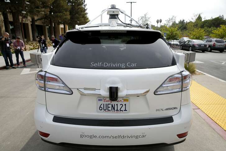 A Lexus RX 350 Hybrid that Google modified into a self-driving vehicle sits parked outside a Google building in Mountain View, California, on Tuesday, Sept. 29, 2015.