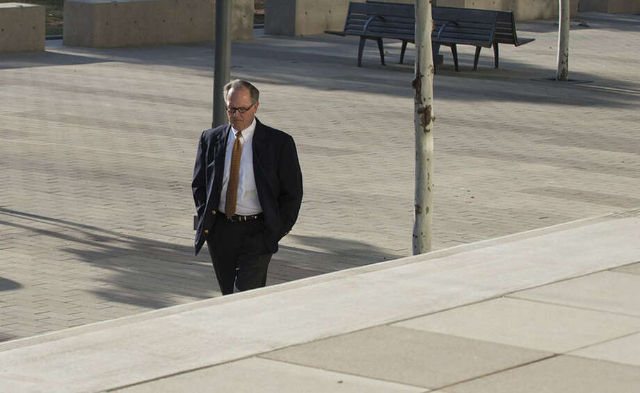 In this file photo, former David Dewhurst consultant Buddy Barfield walks to Austin federal court in October 2014, to plead guilty to embezzling almost $2 million in campaign funds.