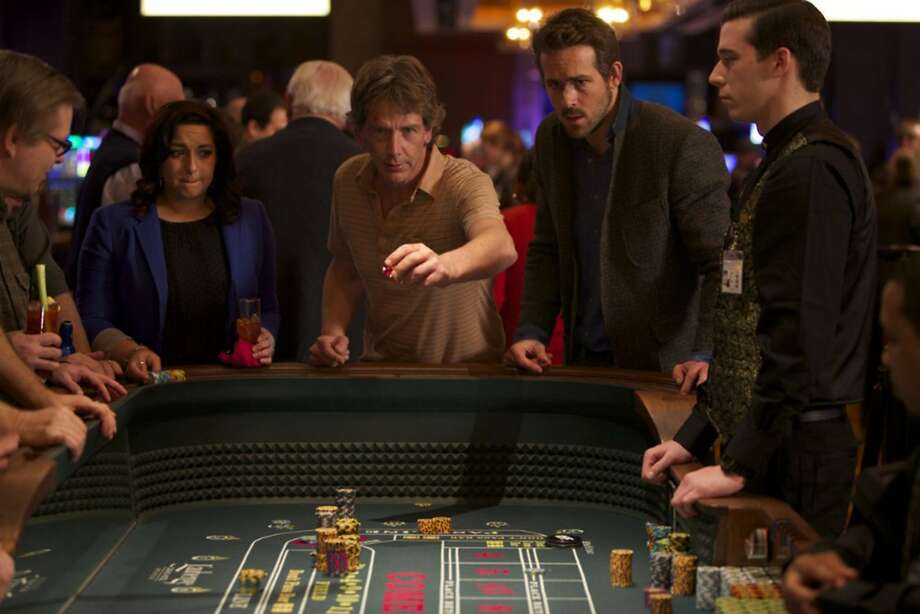 "Ben Mendelsohn (center) and Ryan Reynolds play gamblers on the run in ""Mississippi Grid,"" a dark and gritty film with a great soundtrack. Photo: A24, McClatchy-Tribune News Service"