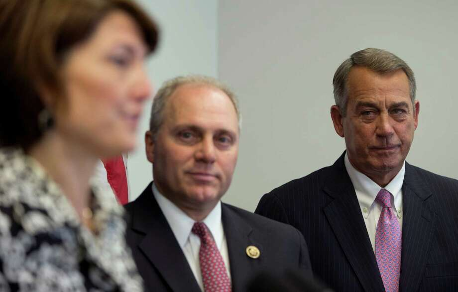 House Majority Whip Steve Scalise of Louisiana, center, said Tuesday he would run for majority leader when Speaker John Boehner of Ohio leaves the House at the end of October. Photo: Carolyn Kaster, STF / AP