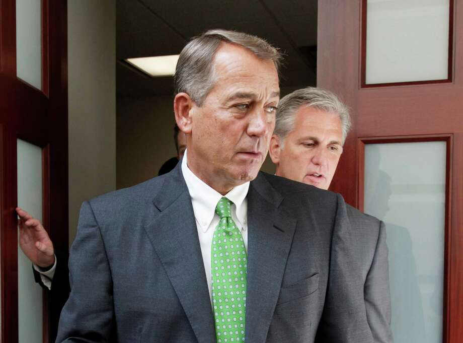 John Boehner was iscaught between the limits of the politically possible and a base that lives in its own reality. Photo: J. Scott Applewhite /Associated Press / AP