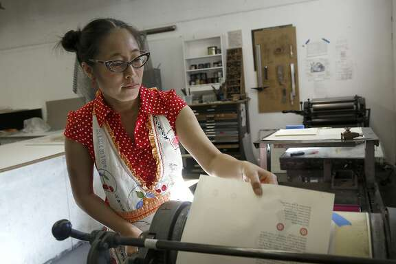 Artist Asuka Ohsawa makes prints for her book in the letterpress studio at the San Francisco Art Institute where she also teaches in San Francisco, Calif., on Friday, September 25, 2015.