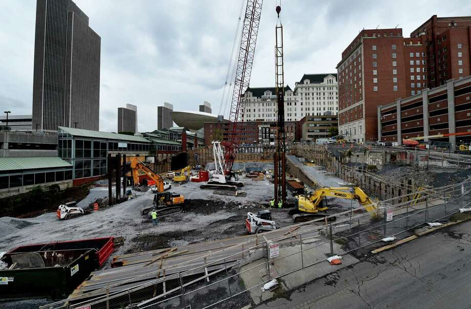 The new Albany convention center is under construction Tuesday afternoon, Sept. 29, 2015, in Albany, N.Y. About 70 percent of the foundation piles for the new downtown convention center have been sunk, and the building?s steel frame is expected to start rising by mid-November, officials said Tuesday. (Skip Dickstein/Times Union) Photo: SKIP DICKSTEIN / 10033549A
