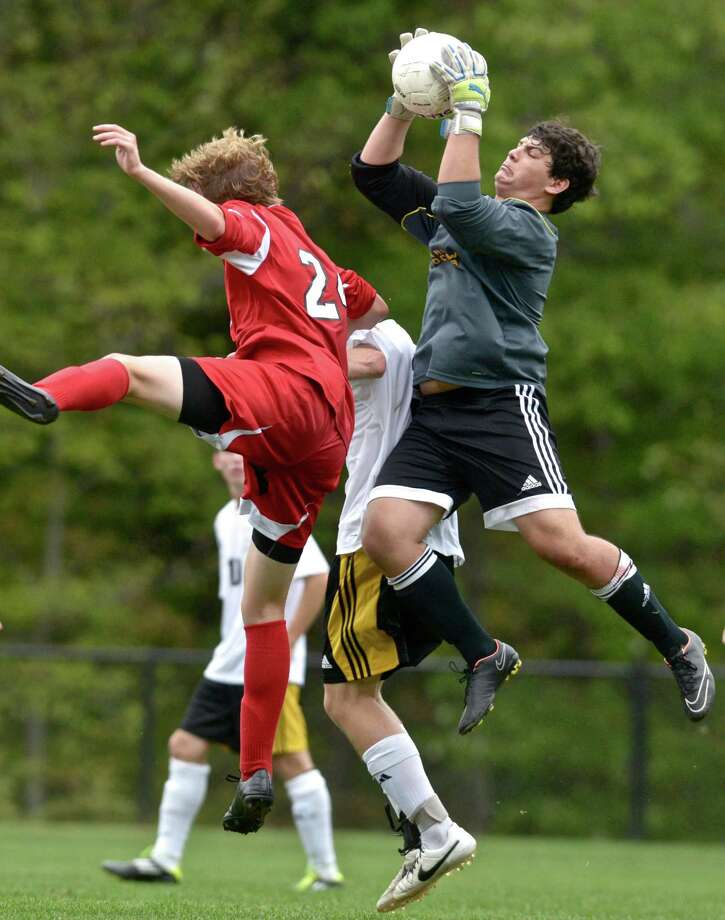 Barlow goalie Scott Bindelglass picks a free kick out of the air over team mate Dan Dolan (3) and Masuk's Peter Zacchilli (24) during their SWC soccer game Tuesday afternoon in Redding. Photo: H John Voorhees III / Hearst Connecticut Media / The News-Times