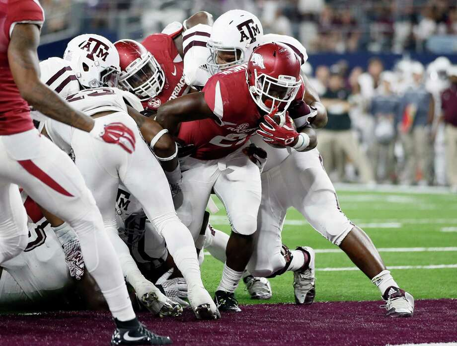 Arkansas running back Rawleigh Williams fights his way into the end zone for a touchdown against Texas A&M during the second half of an NCAA college football game on Saturday, Sept. 26, 2015, in Arlington, Texas. Texas A&M won in overtime, 28-21. Photo: Tony Gutierrez /Associated Press / AP