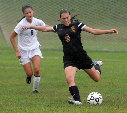 Colonie's Ashley Abel clears the ball as Shen's Sara Conroy pursues during their girl's high school soccer game on Tuesday Sept. 29, 2015 in Clifton Park  , N.Y.  (Michael P. Farrell/Times Union) Photo: Michael P. Farrell / 00033521A