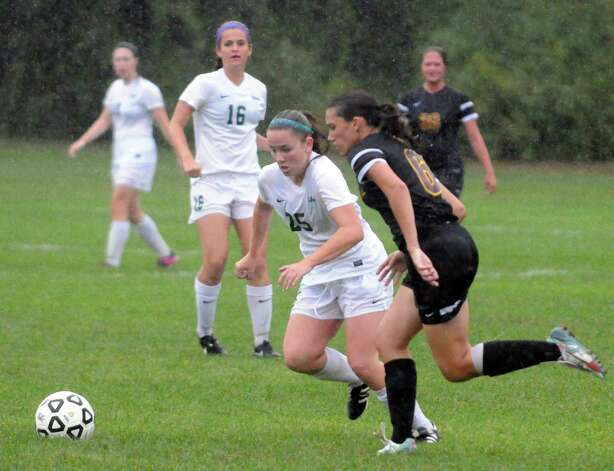 Shen's Meghan Cavanaugh and Colonie's Ashley Abel battle for the ball during their girl's high school soccer game on Tuesday Sept. 29, 2015 in Clifton Park  , N.Y.  (Michael P. Farrell/Times Union) Photo: Michael P. Farrell / 00033521A