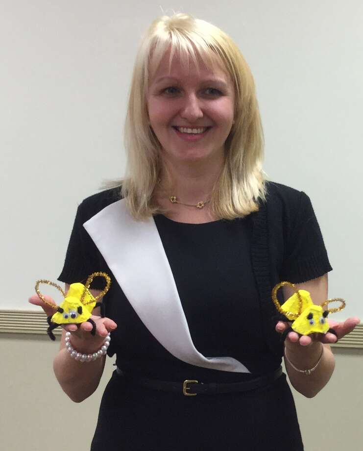 """Alina Boie, a psychologist in the school district, shows the """"bees"""" made of egg cartons and pipe cleaners that Glenville School students will hand out Wednesday at the Starbucks to promote the district's Log Off and Listen In Day. Photo: Paul Schott"""