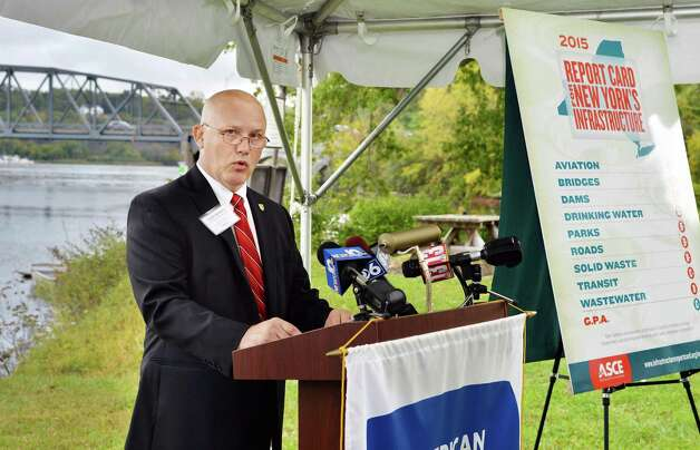 Mark Rusnica, a fellow at the New York Council of the American Society of Civil Engineers, presents the 2015 Report Card for New York?s Infrastructure during a news conference just above the Rexford Bridge on the Mohawk River Tuesday, Sept. 29, 2015 in Niskayuna, N.Y.  (John Carl D'Annibale / Times Union) Photo: John Carl D'Annibale / 00033533A