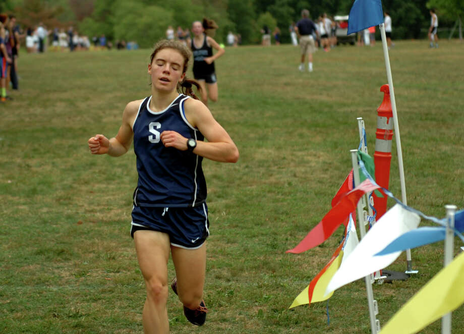 Staples' Susannah Martin crosses the finish line during girls cross country action at Wavenly Park in New Canaan, Conn., on Tuesday September 29, 2015. Photo: Christian Abraham / Hearst Connecticut Media / Connecticut Post