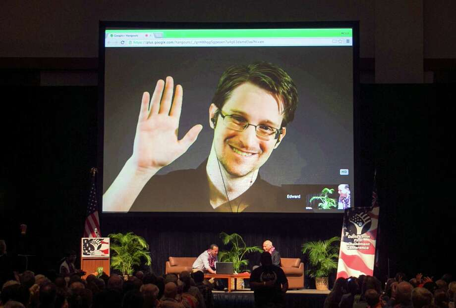 Edward Snowden got 160,000 followers in his first hour after joining Twitter. appears on a live video feed broadcast from Moscow at an event sponsored by ACLU Hawaii in Honolulu. The former National Security Agency worker, who leaked classified documents about government surveillance, started tweeting Tuesday, Sept. 29, 2015. (AP Photo/Marco Garcia, File) Photo: Marco Garcia, FRE / FR132414 AP