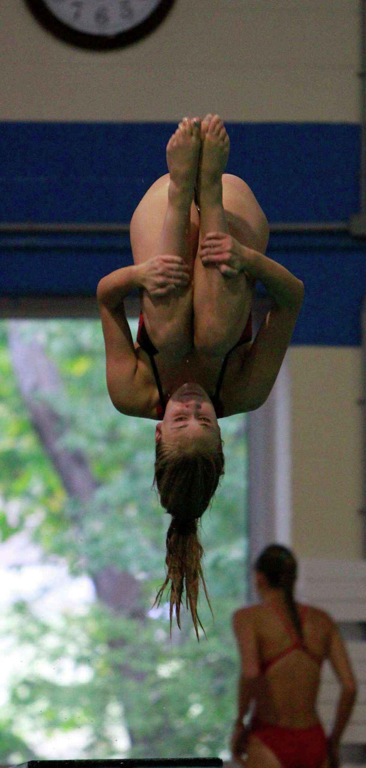 Greenwich and New Canaan compete during a varsity girls swim meet in New Canaan on Tuesday, Sept. 29, 2015.