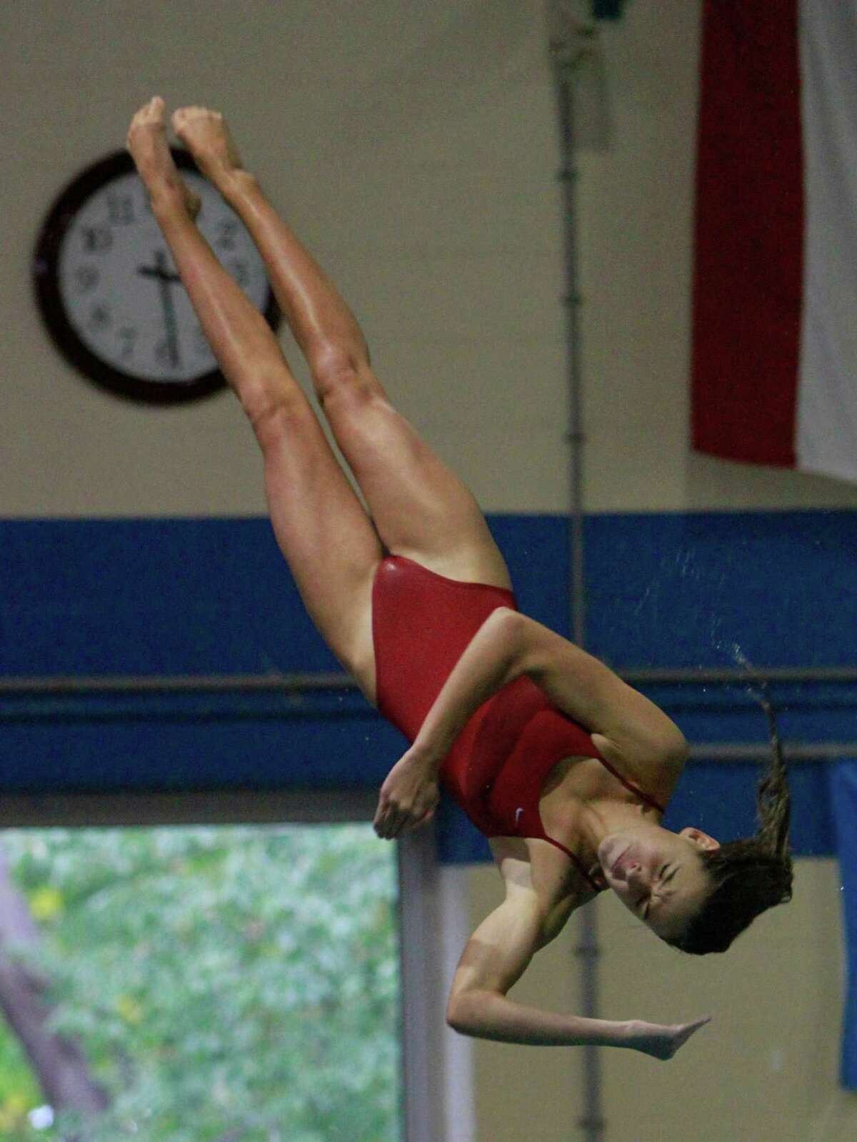 Greenwich's Annabelle Pollack competes in the Diving event of a varsity girls swim meet against New Canaan in New Canaan on Tuesday, Sept. 29, 2015.