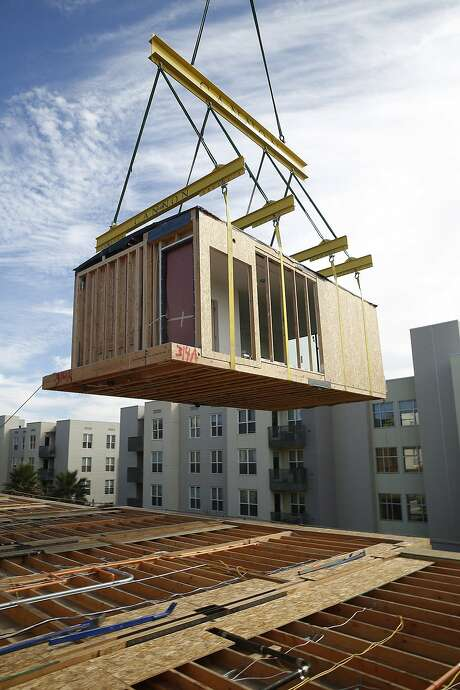 A 136-unit rental housing project takes place in the Bayview in San Francisco, Calif., on Monday, September 28, 2015.  The developer, Rick Holliday, says he is building twice as fast and saving 25 percent on costs. Photo: Liz Hafalia, The Chronicle