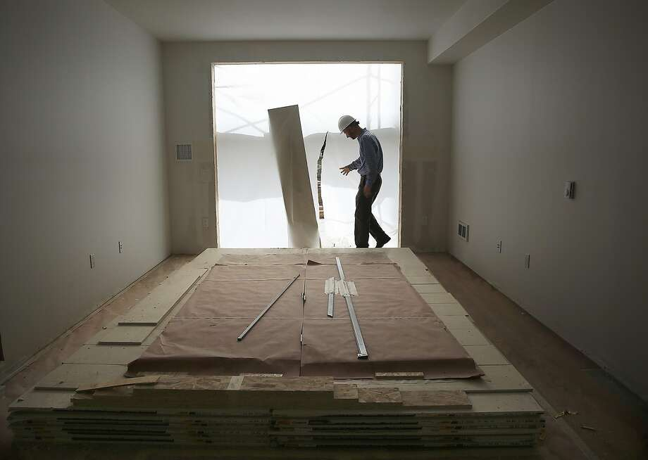 A 136-unit rental housing project takes place in the Bayview in San Francisco, Calif., where placed units already have sheetrock and materials to finish on Monday, September 28, 2015. Photo: Liz Hafalia, The Chronicle