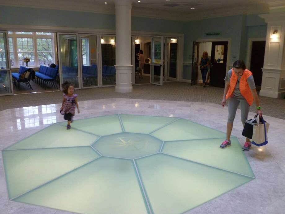 "Kaitlyn ""K.K""  Kwun runs under the skylight in the Noroton Presbyterian Church's new Skylight Fellowship Lobby as her mother Susan Kwun looks on. The church and an expanded facilities recently were rededicated after a three year $13 million renovation. Photo: Martin Cassidy / Hearst Connecticut Media / Darien News"