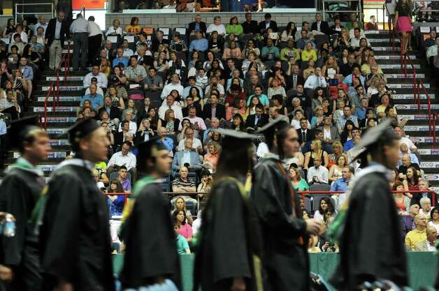 Family and friends watch as graduates process in during Siena College commencement at the Times Union Center on Sunday, May 10, 2015, in Albany, N.Y.  (Paul Buckowski / Times Union archive) Photo: PAUL BUCKOWSKI / 00031513A
