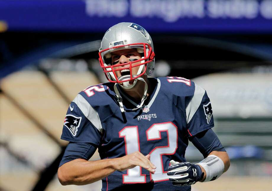 New England Patriots quarterback Tom Brady  takes the field to warm up before an NFL football game against the Jacksonville Jaguars, Sunday, Sept. 27, 2015, in Foxborough, Mass. (AP Photo/Charles Krupa) ORG XMIT: FBO102 Photo: Charles Krupa / AP