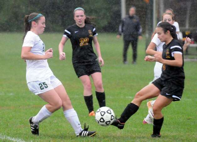 Colonie and Shenendehowa battle it out in a steady rain during their girl's high school soccer game on Tuesday Sept. 29, 2015 in Clifton Park  , N.Y.  (Michael P. Farrell/Times Union) Photo: Michael P. Farrell / 00033521A