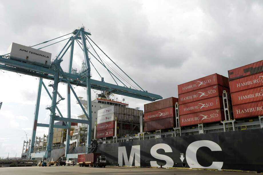 The MSC Oriane container ship is shown at the Port of Houston Authority's Barbours Cut Container Terminal on Tuesday. It is the first deeper draft container ship to go to the Barbours Cut terminal since dredging was completed. Photo: Melissa Phillip, Staff / © 2015 Houston Chronicle